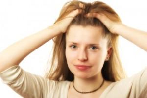 Beautiful blonde woman brushing her hair over white